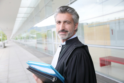 Portrait of lawyer standing outside courthouse building